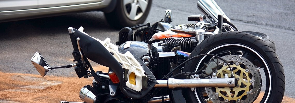Motorcycle on its side in the road