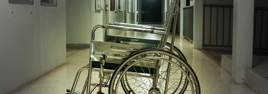 empty wheelchair in an empty hallway