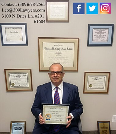 Attorney Leo Ghantous sitting with his awards