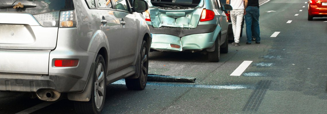 Scene of a Car accident with a teal car rear ended