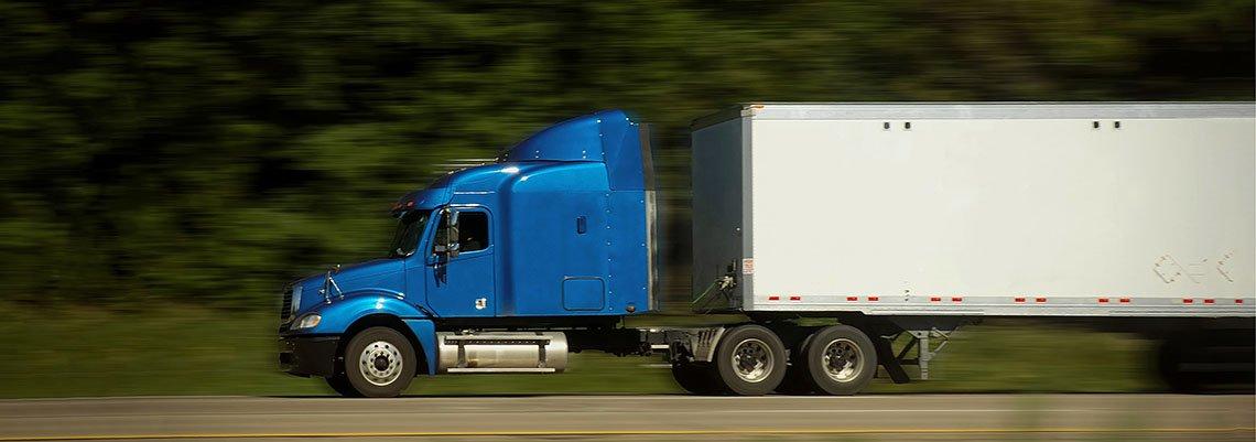 Semi truck driving down the interstate