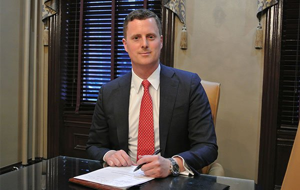 Attorney Chad Maloney at his desk