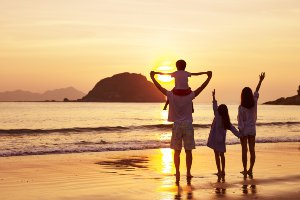 Family of 4 watching a sunset