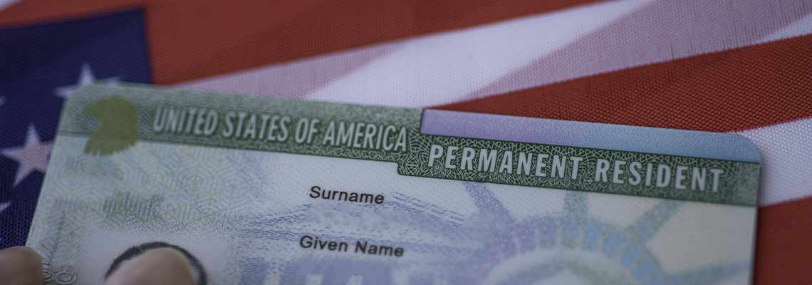 Green card on American flag