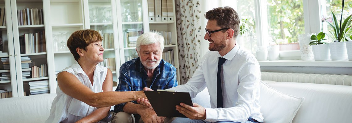 An older couple meeting with an attorney to review some documents