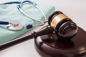 Gavel next to a Stethoscope