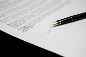 Pen on a document ready to sign
