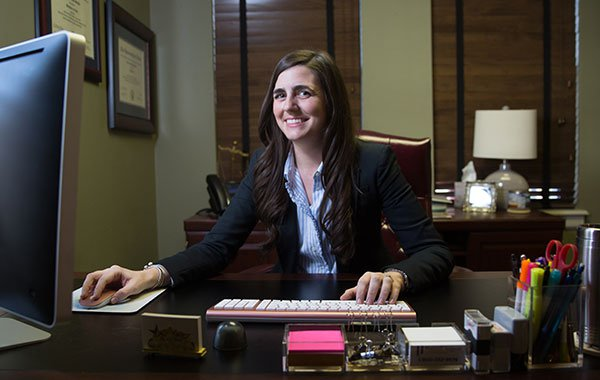 Attorney Chelsea Shields working at her desk