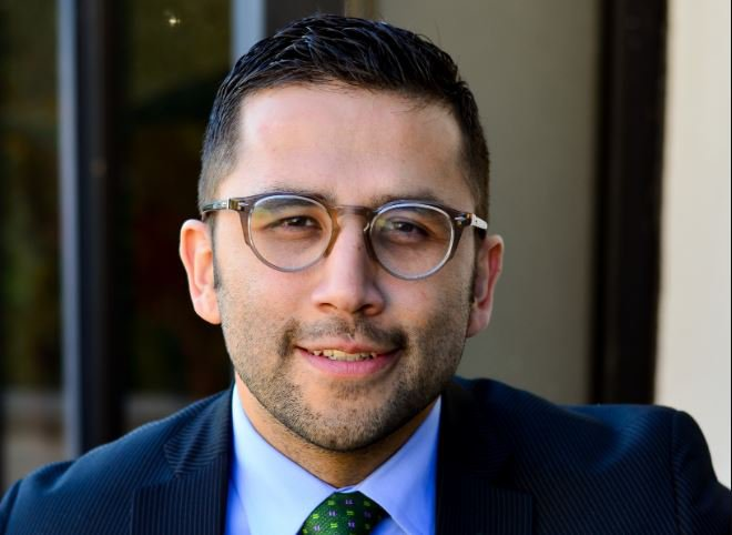 Headshot of attorney Luis Flores