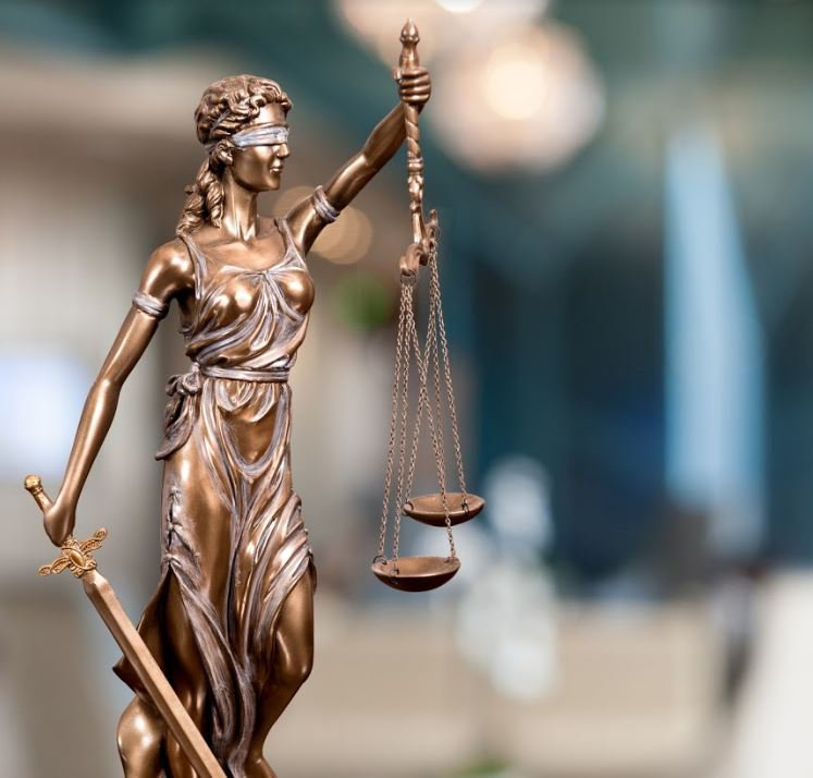 Lady justice holding scales of justice