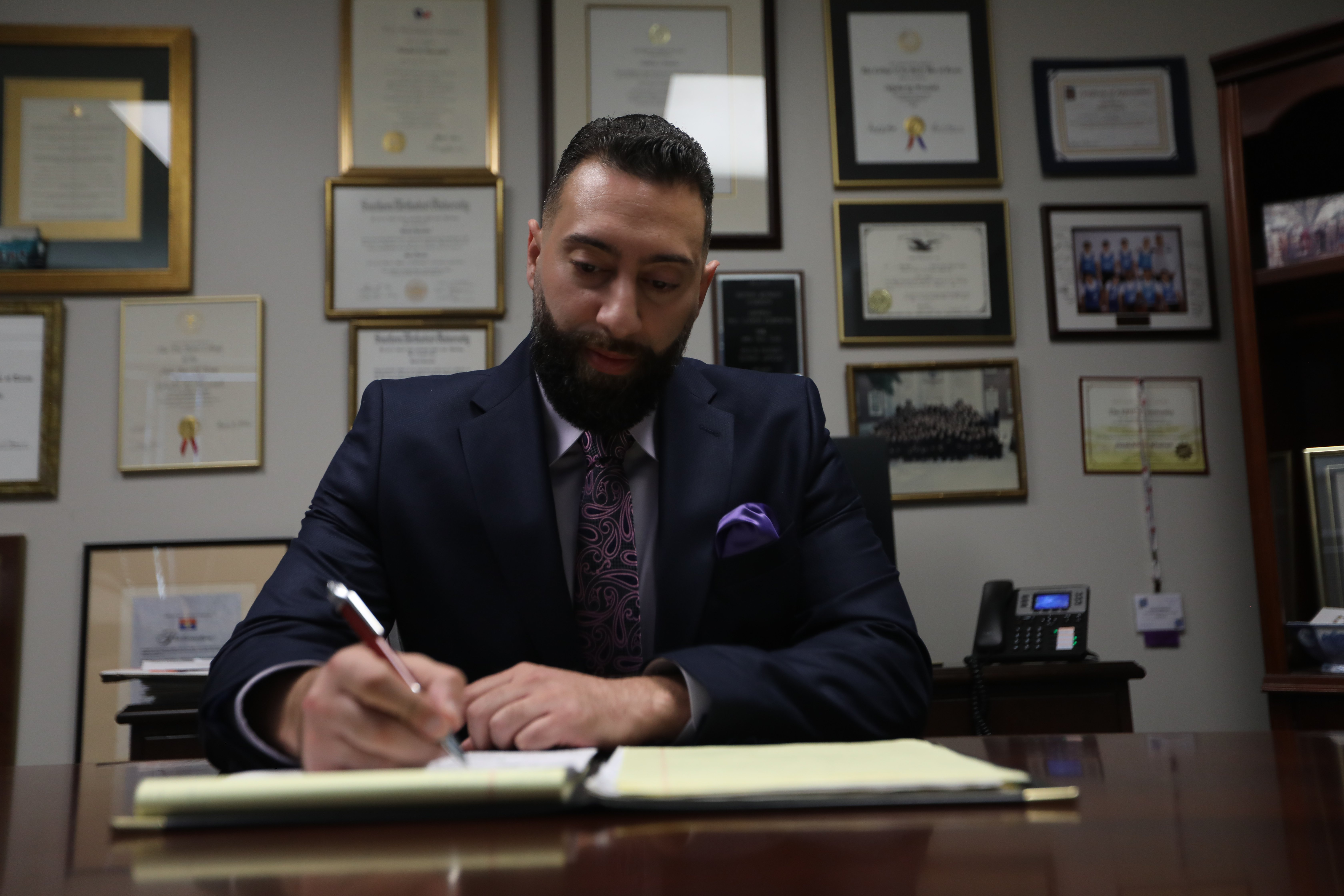 Attorney Hamideh writing on a legal pad