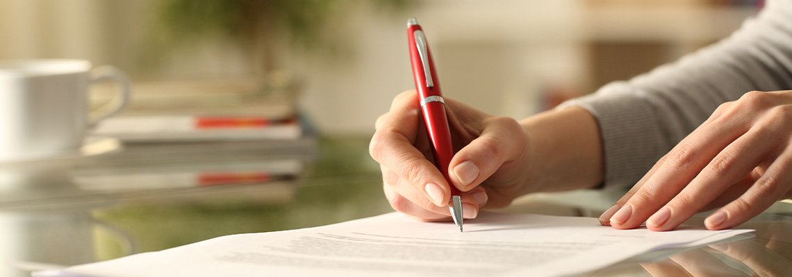 Hand holding Pen signing Paper