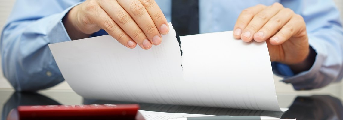 Businessman tearing up  a paper