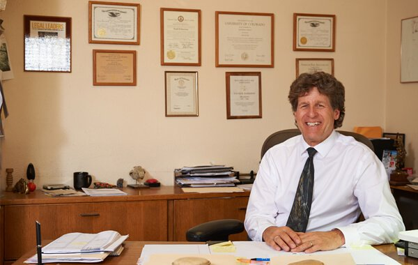 Attorney David Harrison sitting at a desk