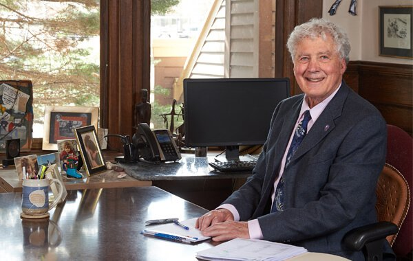 Attorney Robert Miller sitting at a desk