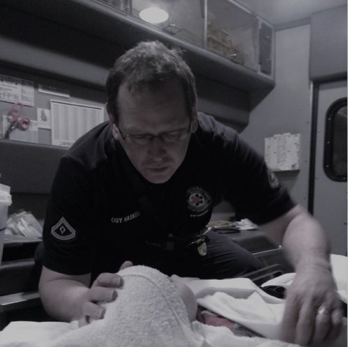 Attorney Haskell helping as an EMT