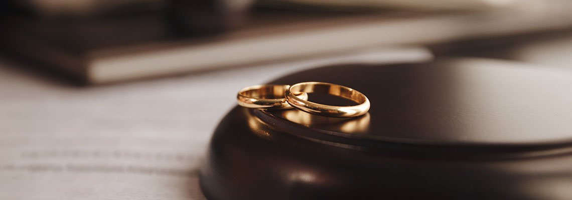 Rings resting on a gavel stand