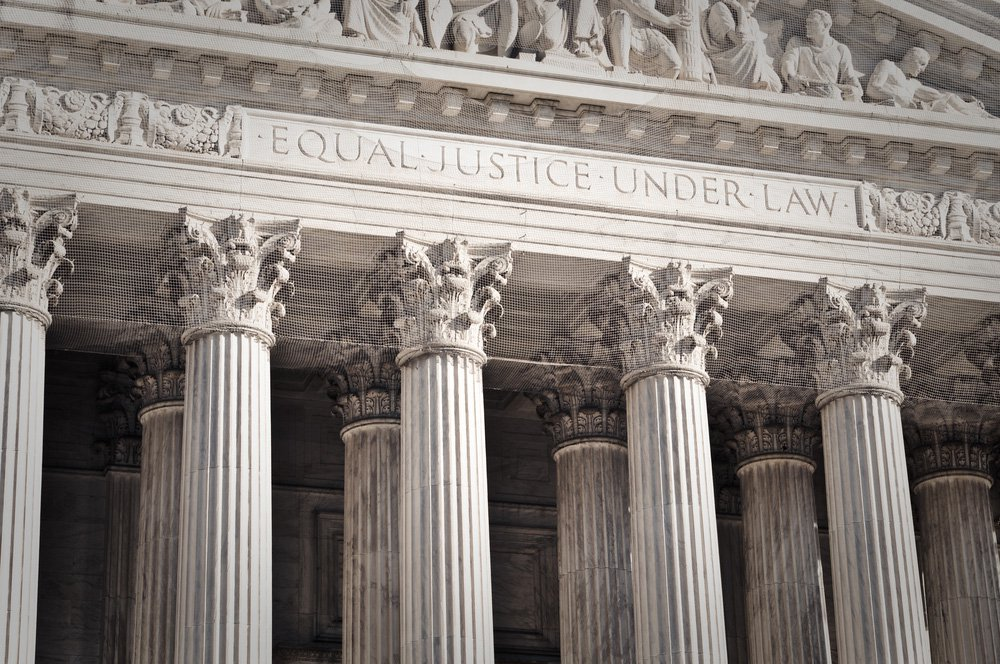 Old building with stone columns and the phrase equal justice under law engraved