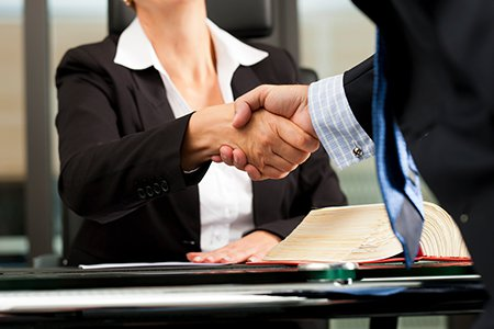 Shakes Hands with a Law Firm on Retainer for your business
