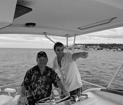 Attorney James A. Heur and Jonathan Fischer On a Boat