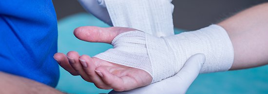 Hand being wrapped in a bandage.jpg