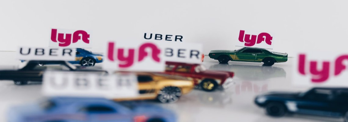 Toy Uber and Lyft cars