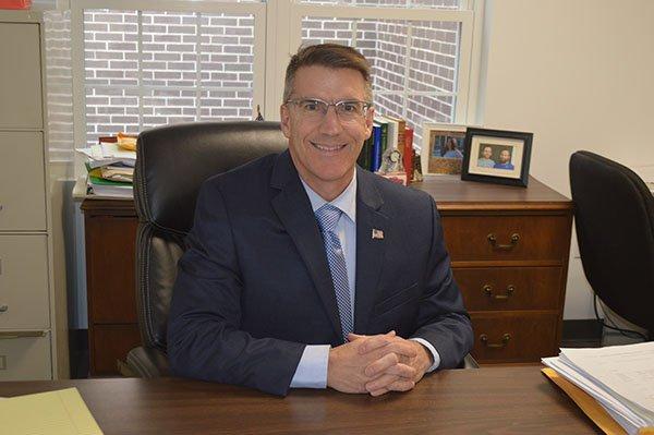 Attorney Dennis Hogan sitting at his desk