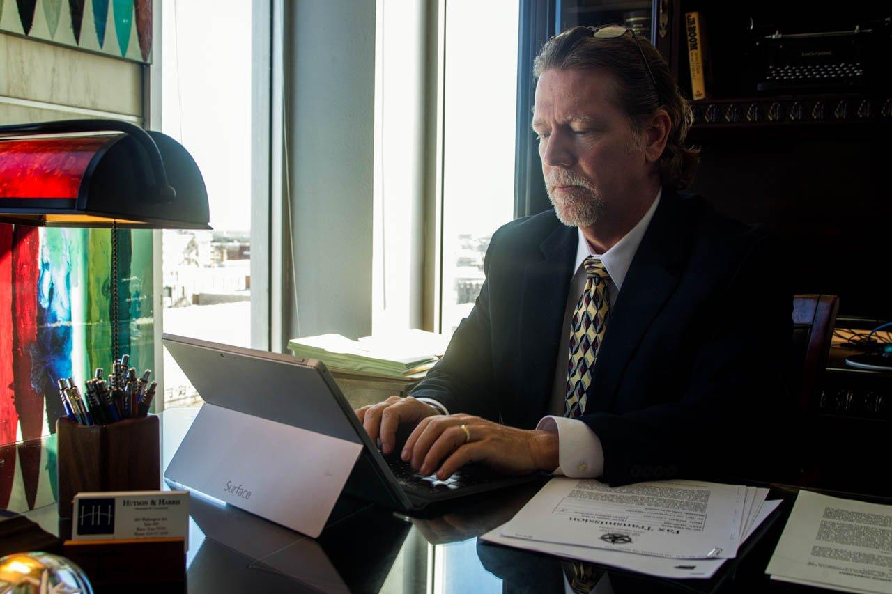 chris looking at his Ipad at his desk