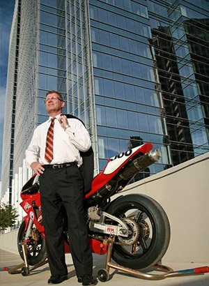 Jeffrey Gilbert standing next to a motorcycle