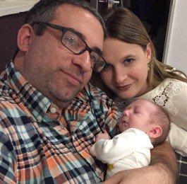 Couple holding infant