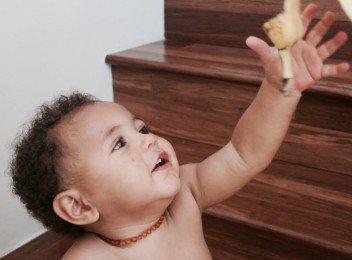 Toddler reaching for banana