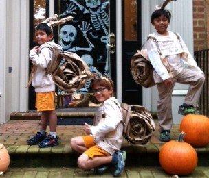 Three boys posing in Halloween costumes