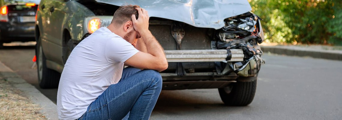 Car-Accident-Man-Holding-His-Head