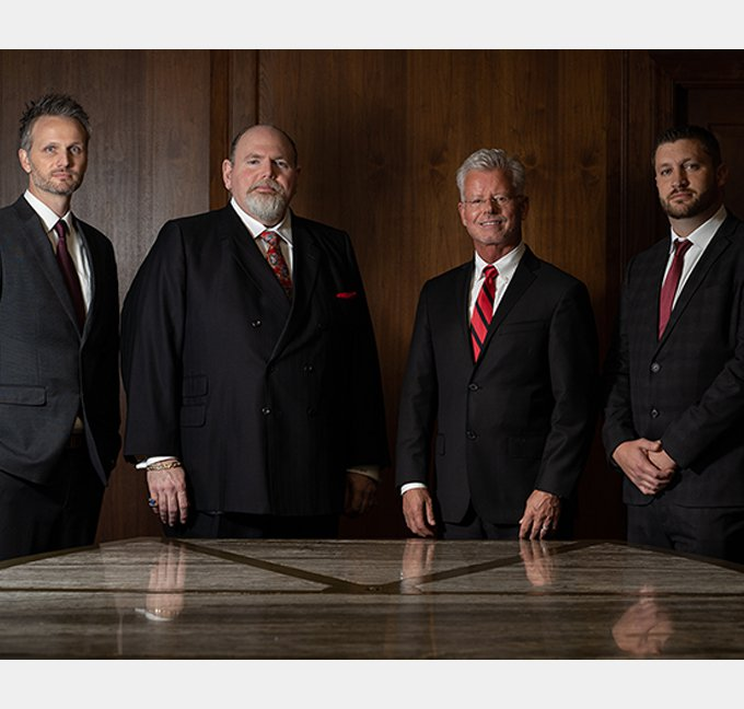 Attorneys standing in a line by a table