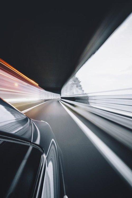 Car moving fast through tunnel