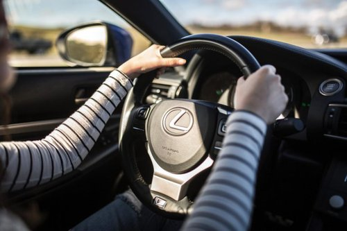 Woman driving with both hands on the wheel