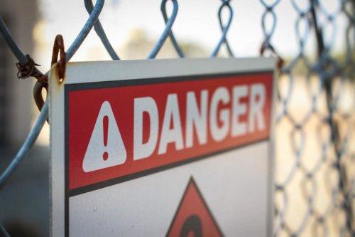 danger sign on fence
