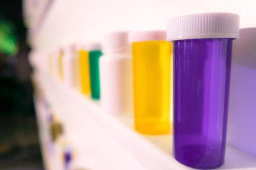 pill bottles lined on a shelf