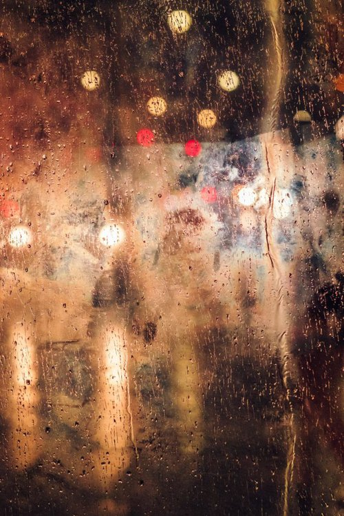 window with rain and blurred lights