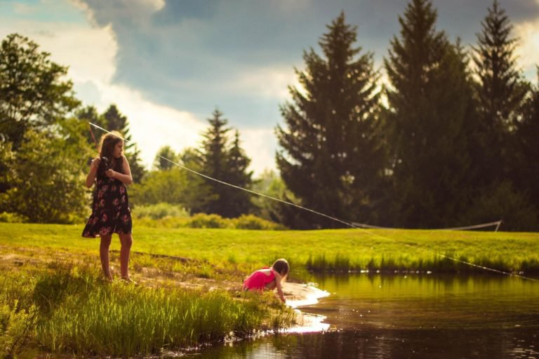 young girl fishing in pond