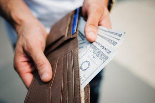 Wallet with 100 dollar bills