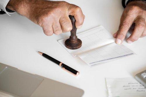 man stamping paper