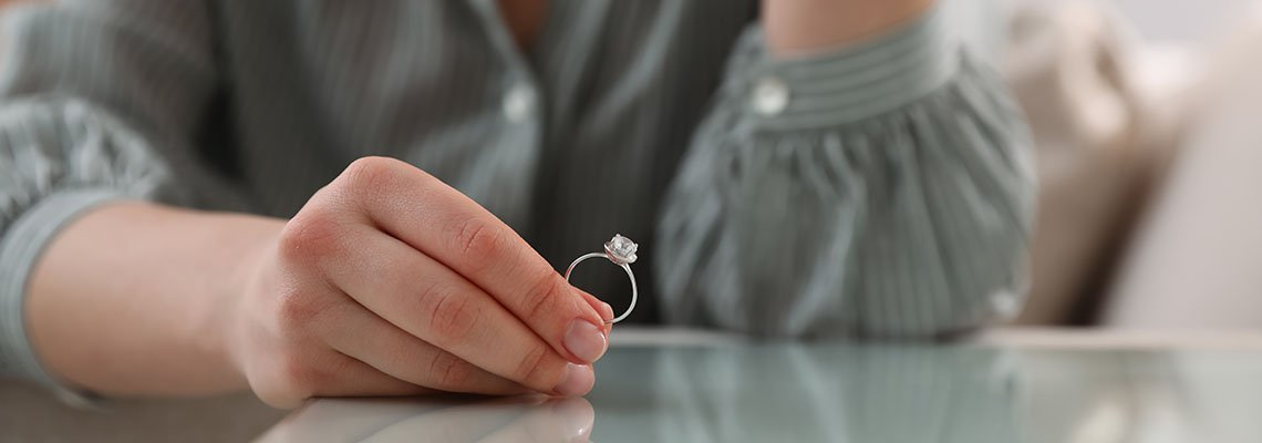 Woman holding a wedding ring