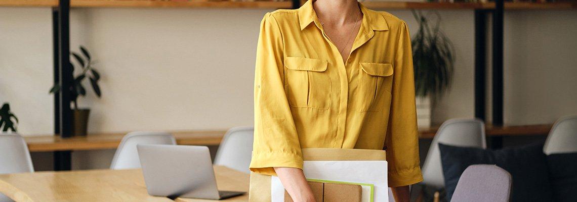 A woman wears a yellow shirt
