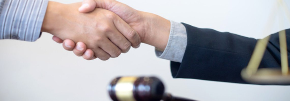 Handshake in Front of Gavel