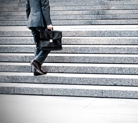 Man in Suit Going Up Stairs