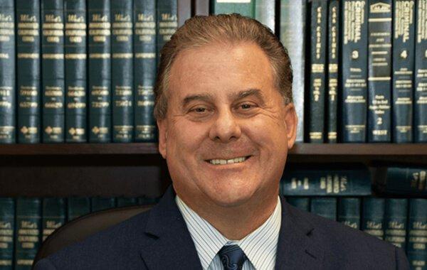 Headshot of attorney Greg Kassel