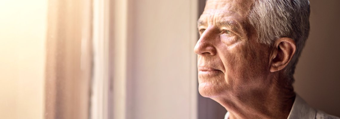 Elderly Man Looking Through the Window