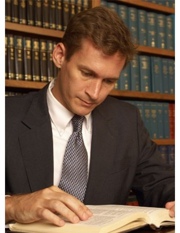Attorney John M. Kirby Reading Law Book