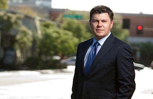 Attorney Roman Kostenko posing outside